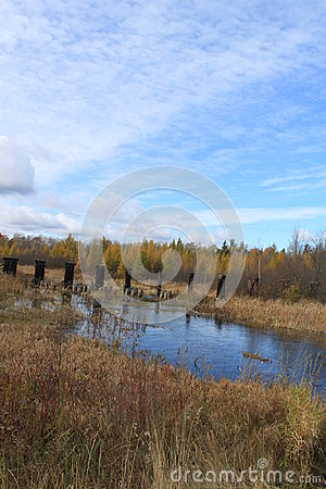 Free View Of Abandoned Bridge In The Distance Amongst Fall Colors Are Reflected In A River In Hayward, Wisconsin Stock Photography - 93308752