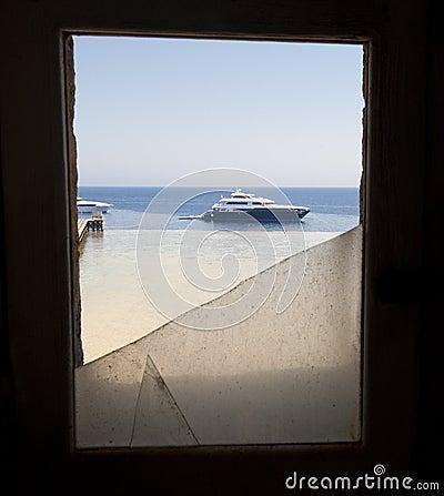 Free View Of Boat Through Broken Window Royalty Free Stock Photo - 25572505
