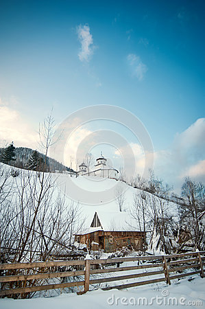 Free View Of Romanian Small Church On Hill Covered With Snow. Winter Landscape With Orthodox Church Over Blue Sky And Wooden Fence Royalty Free Stock Photos - 48775398