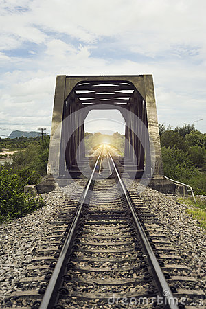 Free View Of The Length Of Railway And Old Steel Bridge,filtered Image,light Effect ,There Light At The End Of The Tunnel,s Royalty Free Stock Images - 75050979