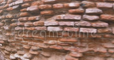 Water Gnawed Brick Wall. View of old water gnawed red brick wall of a building stock video