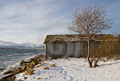 View of  old wooden house in the winter beach