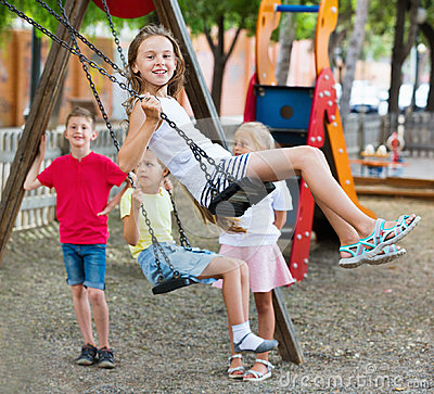 Free View On Children Swinging Together On Children`s Playground Stock Photo - 95270540
