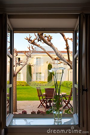 Free View Out Of Opened Window With Vase On Sill To Backyard With Patio, Formal Garden Of Chateau Cordeillan-Bages, Bordeaux, France. Stock Photo - 157970340