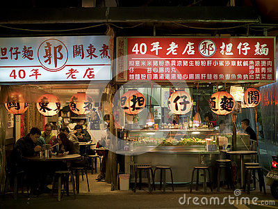 View of people eating in restaurant at Liaoning Street night mar Editorial Stock Photo