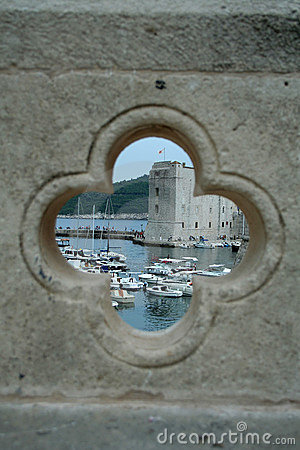 View on the port in Dubrovnik from the hole in bridge