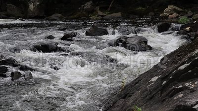 Rushing Rapids On The Yamaska River In Granby, Quebec. View of rapids on the Yamaska River in Granby, Quebec, Canada, just below the remnants of a mill dam stock video