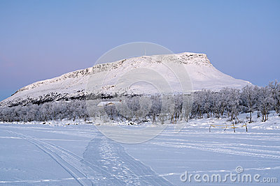 View of Saana Hill from Kilpisjarvi lake in winter, Finland