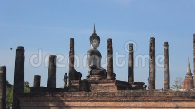 View of the sculpture of a Buddha, Wat Mahathat. Sukhothai, Thailand. SUKHOTHAI, THAILAND - DECEMBER 24, 2018: View of the sculpture of a sitting Buddha on the stock video footage