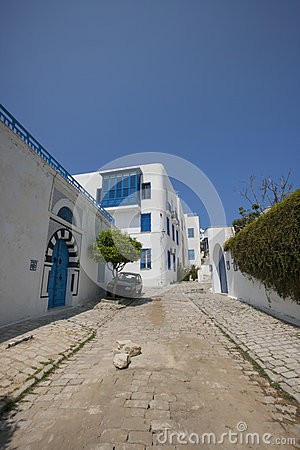 View of street and residential building against clear blue sky, Tunis, Tunisia
