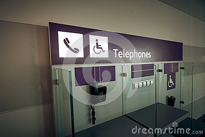 View of telephones in airport terminal