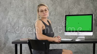 Proud freelance woman posing at office and looking at you. View to computer screen. Green Screen Mock-up Display. View to the screen of computer. Proud stock video