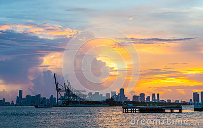 View to the skyline of Miami with docks in the foreground at sunset
