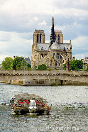 View of tourist boat and the Notre-Dame de Paris