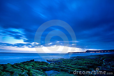View of tropical rocky beach landscape at sunrise