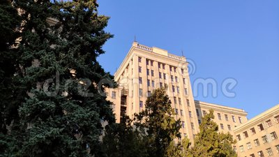 View up of state industry building or gosprom built in construction art over blue sky. Sun ray in the sky stock video footage