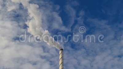 View of white smoke from chimney on blue sky background. Ecology and greenhouse effect concept.  stock video