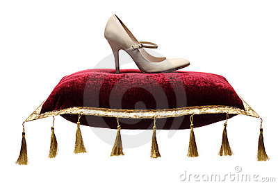 A view of a woman s shoe on a pillow