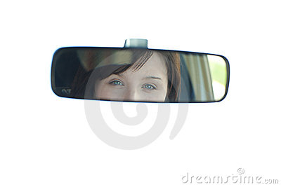 View of a young woman through the rear-view mirror