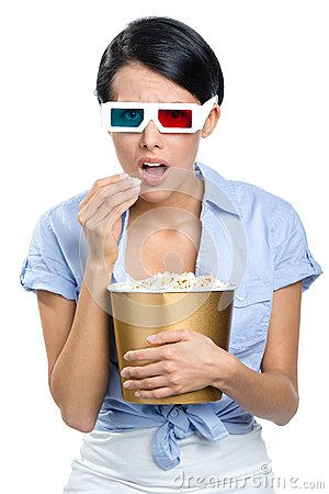 Viewer watching 3D movie with bowl of popcorn