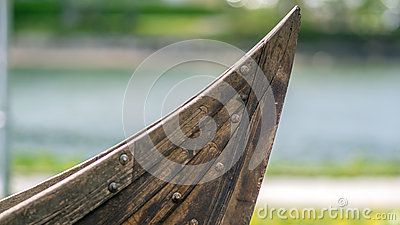Small viking ship like boat bow showing the clinker built hull.