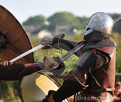 Viking warriors fight.
