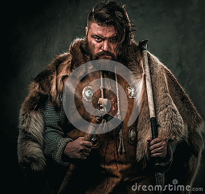 Free Viking With Cold Weapon In A Traditional Warrior Clothes Royalty Free Stock Photography - 97981777