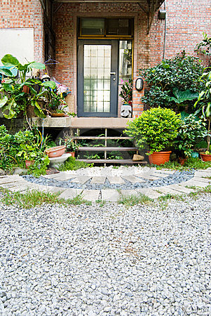 Villa backyard with green plant and pebbles