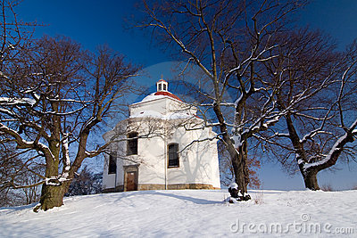 Village chapel in winter countryside