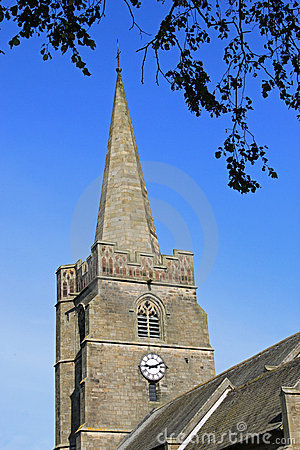 Village Church tower with spire and clock.