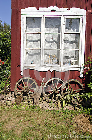 Free Village House Old Window With Ancient Horse Carriage Wheel Stock Photography - 43321702