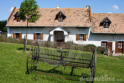 Village house with rake