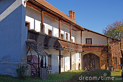 Village house with wooden balcony