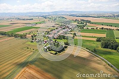 Village landscape over clouds