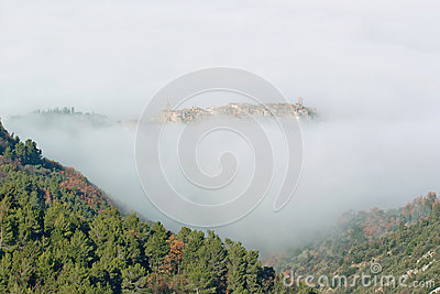 The village of stroncone shrouded in fog