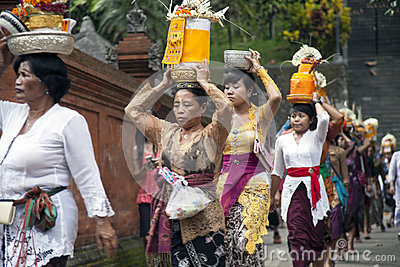 Village women carry offerings of food baskets Editorial Photo