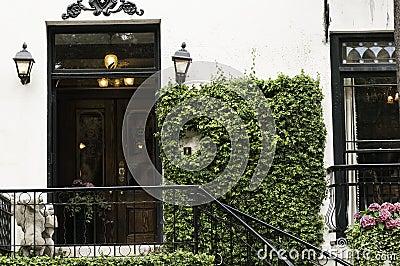 Vine covered mansion entrance