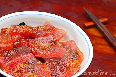 Vinegared rice topped with sliced raw tuna