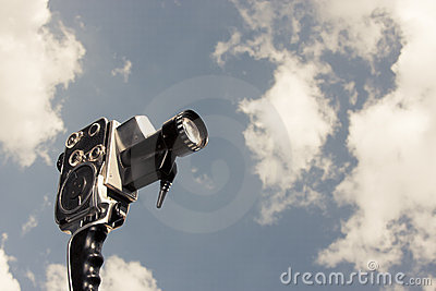 Vintage 8mm camera isolated on white