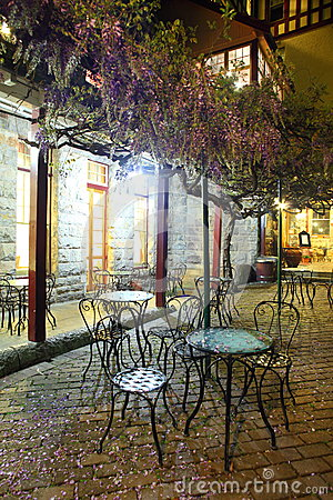 Petals covering bistro chairs night scenery