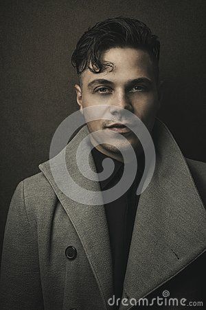 Free Vintage And Retro Portrait Of Illuminated Man In Grey Coat With Brown Background. Young Guy With Old Hairstyle. Fashion Portrait Stock Photo - 101733980