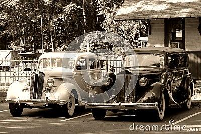 Vintage Automobiles at an Antique Train Station