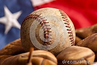 Vintage baseball, glove and American flag