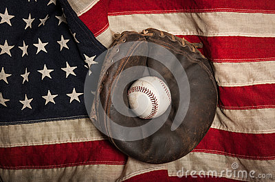 Vintage baseball glove on an American flag