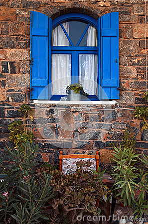Vintage blue window, Greece.