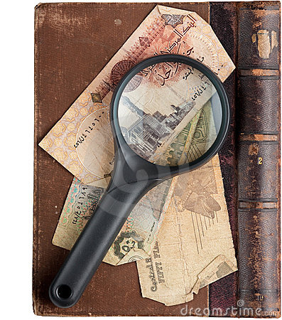Vintage book with magnifying glass
