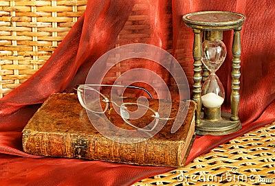Vintage book and old frameless glasses