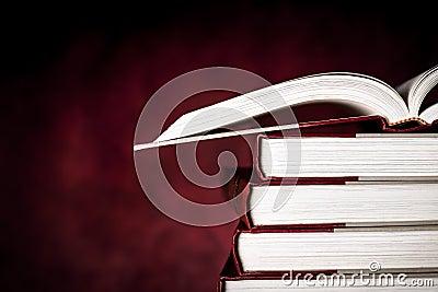 Vintage Books over Red Grunge Background