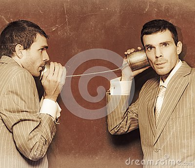 Vintage Business People Talking On Can Telephone