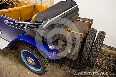 Vintage Car with Travel Suitcase